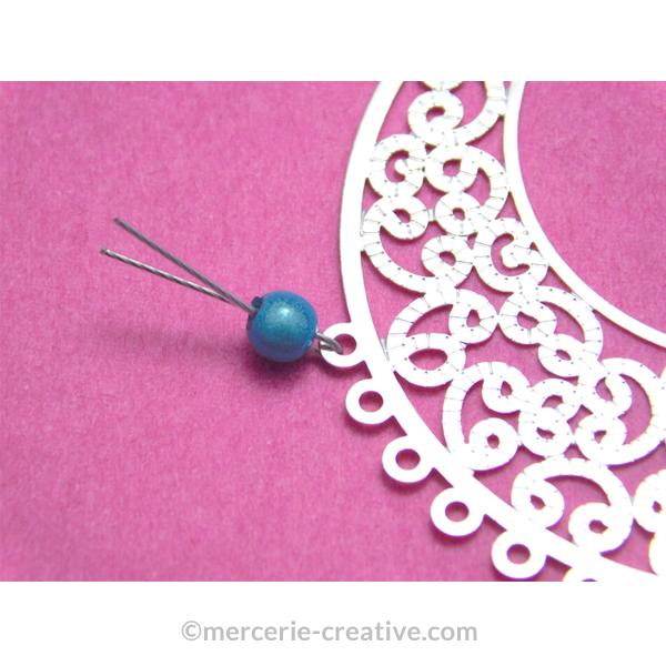 Insérer la perle magique dans le fil cable